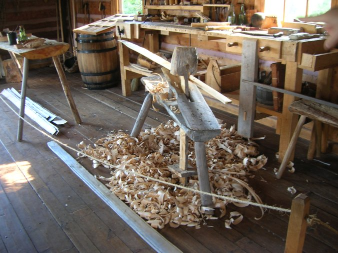 Tools for making a birch bark canoe.