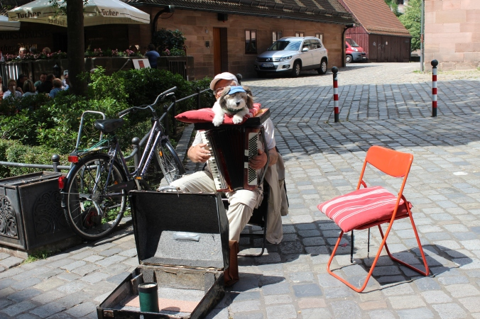I'll just leave you with this picture of a busker playing the accordion with his dog hanging out on top.